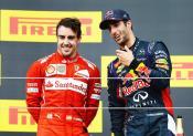 Fernando Alonso and  Daniel Ricciardo on the podium in Hungary