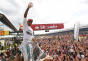 Lewis Hamilton celebrates victory at Silverstone